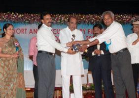Receiving award from Ramanaidu